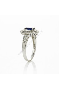 Blue Sapphire and Pave Set Diamond Ring